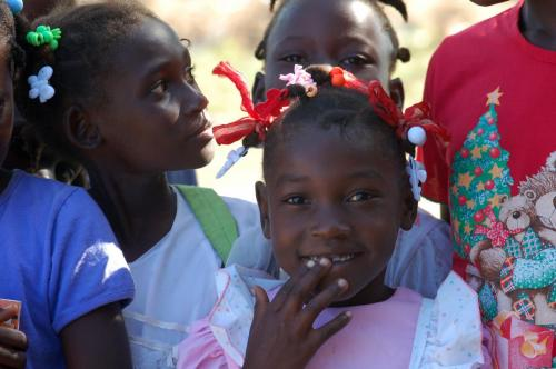 Haitian girl with hand on mouth