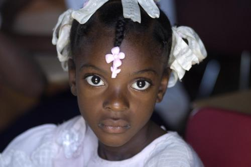 Little Haitian girl in white dress