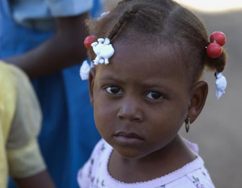 Little girl in Haitian fishing village at Cap-Haitien.
